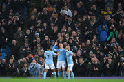 Kevin De Bruyne of Manchester City celebrates his sides second goal with Raheem Sterling of Manchester City and David Silva of Manchester City during the Premier League match between Manchester City and Watford at Etihad Stadium on January 2, 2018 in Manchester, England.