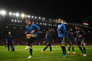 Robin van Persie (L) of Fenerbahce and teammates warm up prior to the UEFA Europa League Group A match between Manchester United FC and Fenerbahce SK at Old Trafford on October 20, 2016 in Manchester, England.
