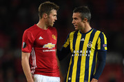 Michael Carrick of Manchester United chats with Robin van Persie of Fenerbahce following the final whistle during the UEFA Europa League Group A match between Manchester United FC and Fenerbahce SK at Old Trafford on October 20, 2016 in Manchester, England.