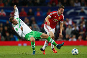 Phil Jones of Manchester United fends off Nicklas Bendtner of VfL Wolfsburg during the UEFA Champions League Group B match between Manchester United FC and VfL Wolfsburg at Old Trafford on September 30, 2015 in Manchester, United Kingdom.