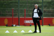 Jose Mourinho, Manager of Manchester United looks on during a training session ahead of their UEFA Champions League Group H match against Juventus at Aon Training Complex on October 22, 2018 in Manchester, England.