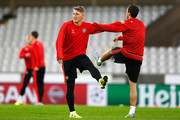 Bastian Schweinsteiger (L) and Matteo Darmian of Manchester United warm up during the Manchester United training session held at Jan Breydel Stadium on August 25, 2015 in Brugge, Belgium.