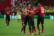 Juan Mata #8 of Manchester United celebrates his goal with teammates during the second half of the International Champions Cup game against the Club America at the University of Phoenix Stadium on July 19, 2018 in Glendale, Arizona.