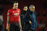 Phil Jones of Manchester United looks dejected after missing his team's eighth penalty, meaning Derby County win the match on penalties during the Carabao Cup Third Round match between Manchester United and Derby County at Old Trafford on September 25, 2018 in Manchester, England.