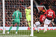 Luis Suarez of Barcelona shoots on goal and sees his shot deflected onto Luke Shaw of Manchester United leading to  his team's first goal during the UEFA Champions League Quarter Final first leg match between Manchester United and FC Barcelona at Old Trafford on April 10, 2019 in Manchester, England. Goal was later given as an own goal by Manchester United's Luke Shaw