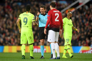 Referee Gianluca Rocchi speaks with Luis Suarez of Barcelona during the UEFA Champions League Quarter Final first leg match between Manchester United and FC Barcelona at Old Trafford on April 10, 2019 in Manchester, England.