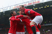 Marouane Fellaini of Manchester United (2R) is congratulated by captain Wayne Rooney (R) and team mates as he scores their second goal with a header during the Barclays Premier League match between Manchester United and Manchester City at Old Trafford on April 12, 2015 in Manchester, England.