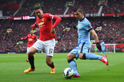 Sergio Aguero of Manchester City is faced by Chris Smalling of Manchester United during the Barclays Premier League match between Manchester United and Manchester City at Old Trafford on April 12, 2015 in Manchester, England.