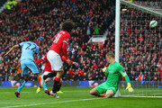 Marouane Fellaini of Manchester United beats goalkeeper Joe Hart of Manchester City to score their second goal with a header during the Barclays Premier League match between Manchester United and Manchester City at Old Trafford on April 12, 2015 in Manchester, England.