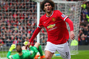 Despair for goalkeeper Joe Hart of Manchester City as Marouane Fellaini of Manchester United celebrates as he scores their second goal with a header during the Barclays Premier League match between Manchester United and Manchester City at Old Trafford on April 12, 2015 in Manchester, England.