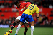 Wilfried Zaha of Manchester United is challenged by Hatem Ben Arfa of Newcastle during the Barclays Premier League match between Manchester United and Newcastle United at Old Trafford on December 7, 2013 in Manchester, England.