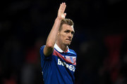 Darren Fletcher of Stoke City waves to supporters during the Premier League match between Manchester United and Stoke City at Old Trafford on January 15, 2018 in Manchester, England.