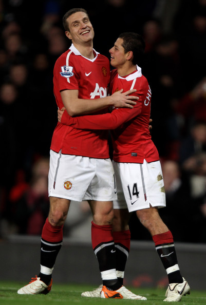 Javier Hernandez of Manchester United celebrates with team mate Nemanja Vidic (L) after scoring the opening goal during the Barclays Premier League match between Manchester United and Stoke City at Old Trafford on January 4, 2011 in Manchester, England.
