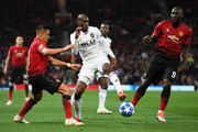 Geoffrey Kondogbia of Valencia is challenged by Alexis Sanchez of Manchester United during the Group H match of the UEFA Champions League between Manchester United and Valencia at Old Trafford on October 2, 2018 in Manchester, United Kingdom.