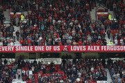 A banner is seen  with a message for Sir Alex Ferguson during the Premier League match between Manchester United and Watford at Old Trafford on May 13, 2018 in Manchester, England.