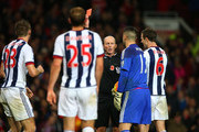 Gareth McAuley (1st L) of West Bromwich Albion is shown a red card by referee Mike Dean (3rd R) during the Barclays Premier League match between Manchester United and West Bromwich Albion at Old Trafford on November 7, 2015 in Manchester, England.