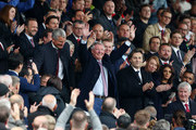 Sir Alex Ferguson waves to fans prior to the Premier League match between Manchester United and Wolverhampton Wanderers at Old Trafford on September 22, 2018 in Manchester, United Kingdom.