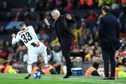 Jose Mourinho, Manager of Manchester United moves back as Federico Bernardeschi of Juventus runs with the ball towards him during the Group H match of the UEFA Champions League between Manchester United and Juventus at Old Trafford on October 23, 2018 in Manchester, United Kingdom.