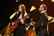 Carla Bruni-Sarkozy and Dave Stewart perform during the dress rehearsal for Mandela Day: A 46664 Celebration Concert at Radio City Music Hall on July 18, 2009 in New York City.