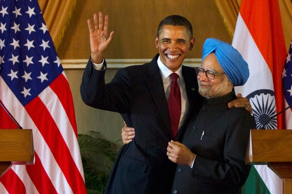 Manmohan Singh U.S. President Barack Obama (L) waves as he is embraced by Indian Prime Minister Manmohan Singh (R) after speaking during a joint press conference at Hyderabad House on November 8, 2010 in New Delhi, India. The US President and the First Lady is on a ten day Asia tour with stops in India as well as Indonesia, South Korea and Japan.