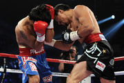 (R-L) Juan Manuel Marquez throws a right to the body of Manny Pacquiao during the WBO world welterweight title fight at the MGM Grand Garden Arena on November 12, 2011 in Las Vegas, Nevada.
