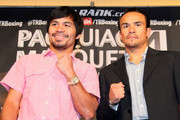 (L-R) Manny Pacquiao and Juan Manuel Marquez stand onstage to face the media cameras during the Manny Pacquiao v Juan Manuel Marquez - Press Conference at Beverly Hills Hotel on September 17, 2012 in Beverly Hills, California.