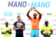 Usain Bolt of Jamaica takes the medal podium after winning the Mano a Mano Athletics Challenge at Jockey Club Brasileiro on April 19, 2015 in Rio de Janeiro, Brazil. (L-R) Churandy Martina of the Netherlands, Ryan Bailley of the United States and Jose Carlos Gomes Moreira of Brazil.