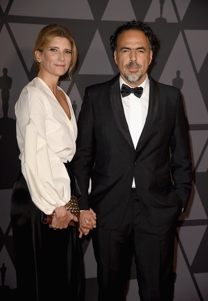Academy of Motion Picture Arts and Sciences' 9th Annual Governors Awards - Arrivals [suit,formal wear,tuxedo,event,white-collar worker,facial hair,pantsuit,premiere,mar\u00eda eladia hagerman,alejandro gonz\u00e1lez i\u00f1\u00e1rritu,hollywood highland center,california,the ray dolby ballroom,academy of motion picture arts and sciences,9th annual governors awards]