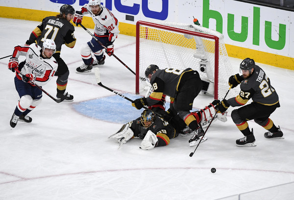 2018 NHL Stanley Cup Final - Game Five [shot,college ice hockey,ice hockey,ice hockey position,sports,hockey,hockey protective equipment,team sport,sports gear,defenseman,ice rink,marc-andre fleury,nate schmidt 88,five,save,vegas golden knights,nhl,washington capitals,stanley cup final,game]