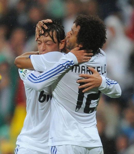 Marcelo Mesut Ozil (L) of Real Madrid celebrates with Marcelo after ...