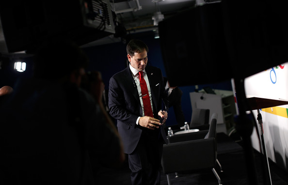 Marco Rubio U.S. Sen. Marco Rubio (R-FL) departs after speaking at Google's office during an appearance before the Jack Kemp Foundation March 10, 2014 in Washington, DC. Rubio discussed Ã'new policies to unleash American innovation and create well paying, middle class jobs during his address as part of the Kemp Forum on economic growth.
