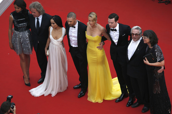 'Mad Max: Fury Road' Premiere - The 68th Annual Cannes Film Festival [mad max: fury road,red carpet,carpet,premiere,red,flooring,event,dress,fashion,yellow,formal wear,premiere,courtney eaton,charlize theron,nicholas hoult,tom hardy,doug mitchell,zoe kravitz,george miller,the 68th annual cannes film festival]