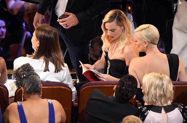 92nd Annual Academy Awards - Show [hair,event,lady,hairstyle,fashion,yellow,blond,ceremony,dress,flooring,charlize theron,margot robbie,l-r,california,hollywood,dolby theatre,92nd annual academy awards,show,margot robbie,harley quinn: birds of prey,academy awards,actor,photograph,photography,bafta rising star award,oyster,charlize theron]