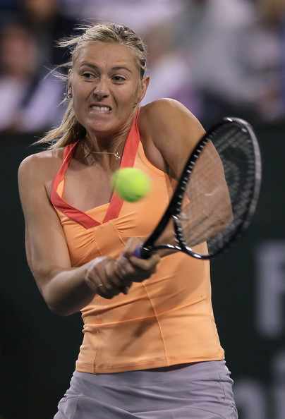 Maria Sharapova Maria Sharapova of Russia returns a backhand to Caroline Wozniacki of Denmark during the semifinals of the BNP Paribas Open at the Indian Wells Tennis Garden on March 18, 2011 in Indian Wells, California.