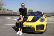 Porsche Brand Ambassadors Maria Sharapova poses after driving with Mark Webber in the high performance sports car Porsche 911 RT2 RS on the Weissach race track before the start of the Porsche Tennis Grand Prix tennis tournament on April 20, 2018 in Stuttgart, Germany.
