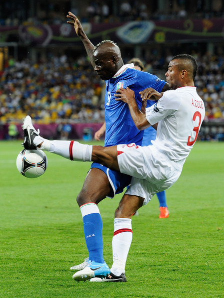 Mario Balotelli Mario Balotelli of Italy and Ashley Cole of England challenge forthe ball during the UEFA EURO 2012 quarter final match between England and Italy at The Olympic Stadium on June 24, 2012 in Kiev, Ukraine.