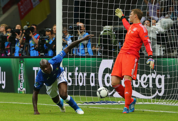 Mario Balotelli Mario Balotelli of Italy celebrates scoring the opening goal past Manuel Neuer of Germany during the UEFA EURO 2012 semi final match between Germany and Italy at the National Stadium on June 28, 2012 in Warsaw, Poland.