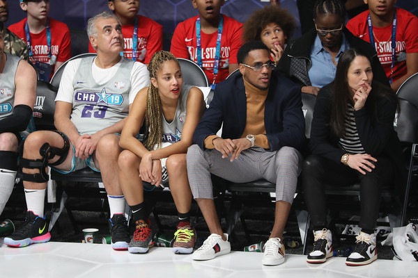 2019 NBA All-Star Celebrity Game - Inside [social group,team,event,footwear,tournament,competition event,championship,crowd,coaches,players,monte morris,amanda seales,sue bird,mark lasry,l-r,bojangles coliseum,team,nba all-star celebrity game - inside]