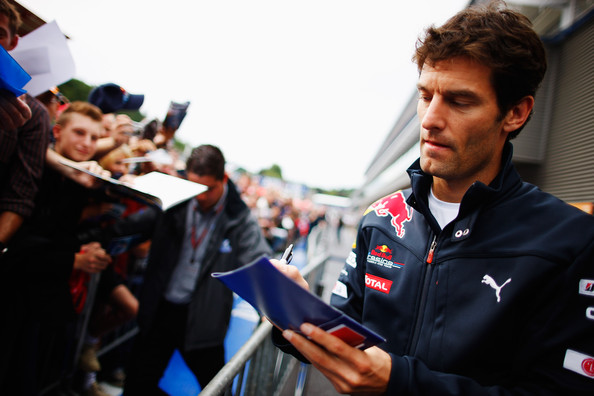 Mark Webber Mark Webber of Australia and Red Bull Racing signs autographs for fans at the drivers autograph session during previews to the Belgian Formula One Grand Prix at the Circuit of Spa Francorchamps on August 26, 2010 in Spa Francorchamps, Belgium.