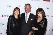 (L-R) Linda Gray, George Hamilton and Dame Joan Collins arrive at a cocktail reception benefiting The Elizabeth Taylor AIDS Foundation at the Mark Zunino Atelier on November 07, 2019 in Beverly Hills, California.