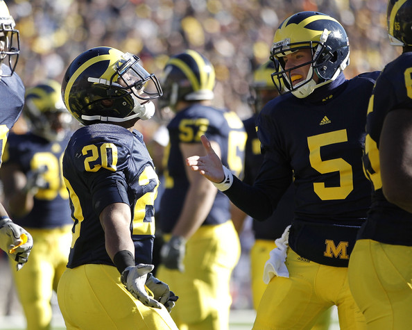 Illinois v Michigan [player,sports gear,sports,helmet,football gear,football equipment,sports equipment,team sport,gridiron football,football helmet,michael shaw,michigan,illinois,michigan stadium,illinios fighting illini,ann arbor,michigan wolverines,tate forcier 5,overtime touchdown,game]