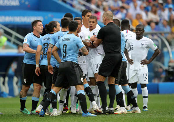 Uruguay vs. France: Quarter Final - 2018 FIFA World Cup Russia [player,sports,sport venue,team sport,ball game,football player,team,soccer player,championship,football,players,uruguay,france,russia,nizhny novgorod stadium,quarter final - 2018 fifa world cup,match,russia quarter final]