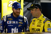 Dale Earnhardt Jr., driver of the #88 Nationwide Chevrolet, talks with Matt Kenseth, driver of the #20 Dollar General Toyota, in the garage area during practice for the NASCAR Sprint Cup Series Goody's Headache Relief Shot 500 at Martinsville Speedway on October 31, 2015 in Martinsville, Virginia.