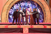 "Marvel Studios' ""Avengers: Endgame"" stars President of Marvel Studios/Producer Kevin Feige, Chris Hemsworth, Chris Evans, Robert Downey Jr., Scarlett Johansson, Jeremy Renner and Mark Ruffalo at the Hand And Footprint Ceremony at the TCL Chinese Theatre on April 23, 2019 in Hollywood, California."