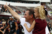 Head coach Dan Mullen of the Mississippi State Bulldogs celebrates with his daughter Breelyn after they defeated the Massachusetts Minutemen 34-23 in an NCAA football game at Davis Wade Stadium on November 4, 2017 in Starkville, Mississippi.