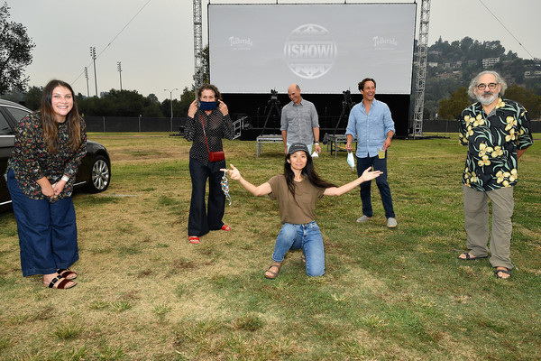 """Fox Searchlight And The Telluride Film Festival Host Drive-In Premiere Of """"Nomadland"""" [grass,community,tree,fun,lawn,team,event,plant,recreation,games,car,stephen gilula,taylor friedman,l-r,tree,nomadland,lawn,fox searchlight,team,the telluride film festival host drive-in premiere,car,lawn,tree,recreational activity,team]"""