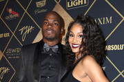 NFL player Adrian Peterson and Ashley Brown arrive at the Maxim Super Bowl Party on February 5, 2017 in Houston, Texas.