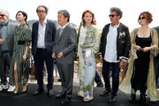 (L-R) Jury members Pedro Almodovar, Fan Bingbing, Paolo Sorrentino, Park Chan-wook, Maren Ade, Gabriel Yared, and Agnes Jaoui attend the Mayor's Aioli during the 70th annual Cannes Film Festival at Palais des Festivals on May 26, 2017 in Cannes, France.