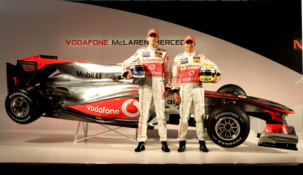 Jenson Button and Lewis Hamilton of Great Britain and team Vodafone McLaren Mercedes unveil the new car for the 2010 Formula 1 season at the headquaters of Vodafone on January 29, 2010 in Newbury, England.