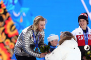 Gold medalist Sage Kotsenburg of the United States receives his flowers from President of the International Ski Federation (FIS) Gian-Franco Kasper during the medal ceremony for the Snowboard Men's Slopestyle  during day 1 of the Sochi 2014 Winter Olympics at Medals Plaza on February 8, 2014 in Sochi, Russia.